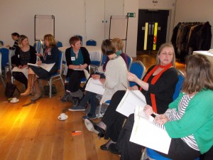 Participants in Birmingham chatting away during the Story of Change activity